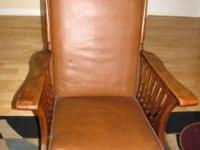Nice wood chair with leater seat and back cushion. Call