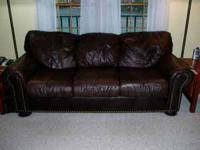 Big, solid, quality brown leather sofa and recliner.