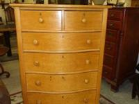 This is a gorgeous tall birds eye maple dresser made by