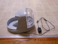 We've up graded our pet feeder and are selling our Le