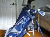 Includes driver, 5,7, and 9 irons, an putte. Only used