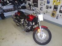 Leftover 2009 Yamaha V-Star 1100 Custom, candy red in
