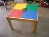 Nice Lego table. Very sturdy. Does not come with any