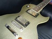 Purchase It Now - $235.00 >)Les Paul styled Boutique