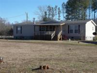 Move to the Country! This 3 bedroom 2 bath double wide