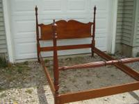 This queen bed frame is from the Lexington company.
