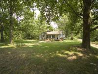 This residence and 125+/- acres are located in Holmes
