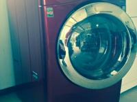 9 Cycle LG Front Load Clothes Washer. Consists of steam