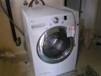 White, used front load washer. We just bought this home