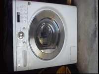 This is a used LG Model WM3431HW washer and dryer in