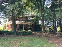 13 acre farm with a brick, 2 story, 2500 sq ft home.