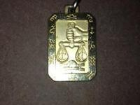 I have a vintage gold toned Libra necklace pendant. I