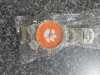 WE HAVE FOR SALE A LICENSED CLEMSON MEN WATCH  IT IS
