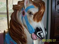 "This 62"" x 62"" reproduction carousel horse is a replica"