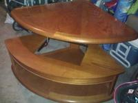 up for grabs is a beautiful lift top coffee table. the