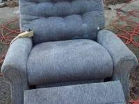 Bluish/grayish medical lift chair for sale. Has a
