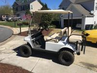 I have a lifter golf cart new batteries headlights back