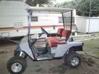 1989 EZGO lifted golf cart gas powered has new tires,