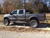 This truck is sure to turn heads. It has a Superlift