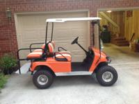 This is a golf cart that is for sale by the sole,