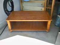 For Sale is a light brown coffee table with a bottom