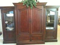 This Light Brown Entertainment Center is $55.00 at the