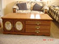 light wood colored end table with two wooden drawers