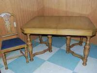 This is a stunning light mahogany table with four
