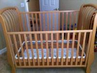 Selling a light wood crib w/ underneath drawer ... Bed