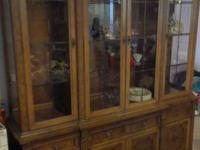 We have a lighted china cabinet for sale we are moving
