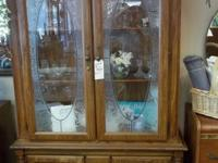 Very elegant looking lighted china hutch with etched