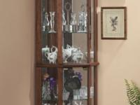 Handsome curio displays collectibles beautifully on