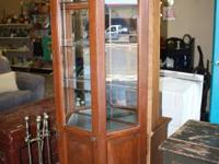 Heavy Obligation Lighted Curio Cabinet constructed from