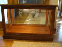 Beautiful lighted curio cabinet. In PERFECT