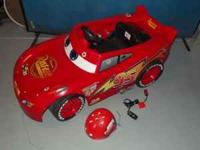Kids six volt powercar,battery charger,helmet all in