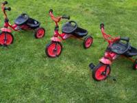 For sale are three Lightning McQueen tricycles from the