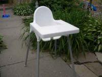 White plastic high chair with built in tray. Asking