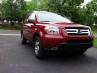 A photo is worth a thousand words! The Red Honda Pilot