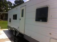 Like new 2006 Smokey by SunRay 30' pull behind RV. The