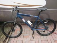 BIKE IS 18 SPEED, COLOR IS BLUE/GRAY, HAS WATER BOTTLE