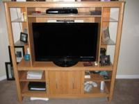 Very nice entertainment center for sale. Outside