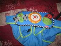 I am selling a Fisher Price High Chair Cover with lots