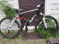 Like new mountain bike for sale. Not sure of the size