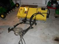 this is a john deere J20C model tiller that has been