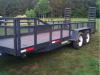 This is a Lawrimore 20ft heavy duty equipment trailer.