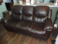 Like new Leather couch, less than a year old from