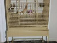This cage has barely been used. It is in new condition,