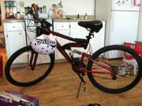 7 speed red and black Mongoose bike with shock