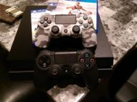 Like New PlayStation 4.... with two controllers, three