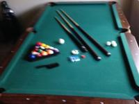 Likd new pool table. Barely ever used. Less than 6